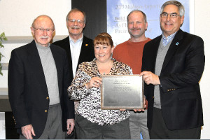 (From left) Jim Quinnell, Chippewa County EDC Board Member; Tom Ewing, President of the CCEDC; Tami Beseau, Airport Manager; Tim Gregory, Airport Maintenance Supervisor and Mike Trout, Executive Administrator, MDOT Office of Aeronautics.